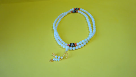 Small White Coral Smoot Bead.