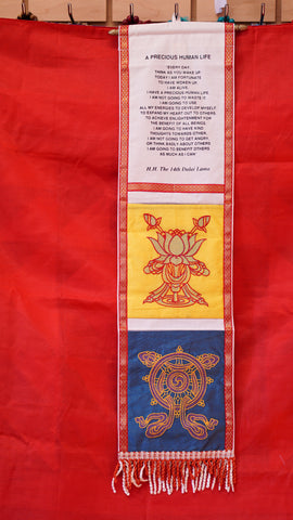 Two pocket decorative wall hanging with His Holiness the Dalai Lama's quote.