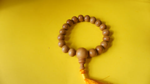Yellow Sandelwood wrist mala.
