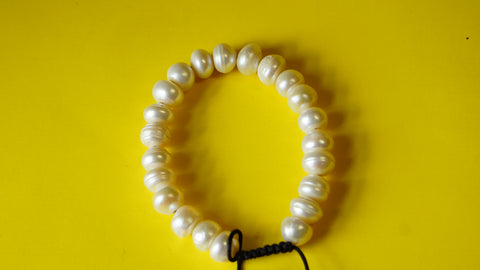 Adjustable White Bamboo Coral Smooth Round Beads.