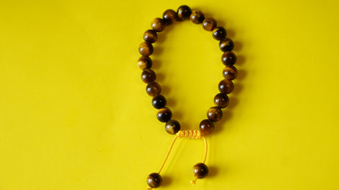 Adjustable Knotted Tiger Eye Mala.