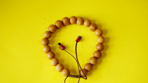 Adjustable Yellow Sandelwood Wrist Mala.