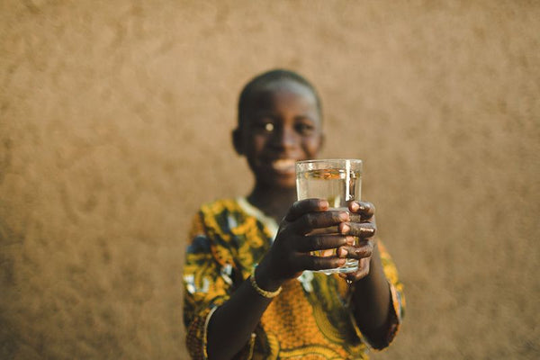 child holding water
