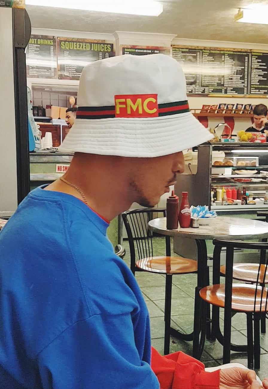 bcc88362c04 Striped Logo Bucket Hat White - FMC For Mass Consumption