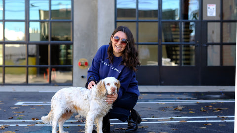 Woman wearing Rescue in Style sweatshirt with rescue dog.