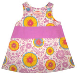 girls caterpillar dress in sunshine by Red Thread Design