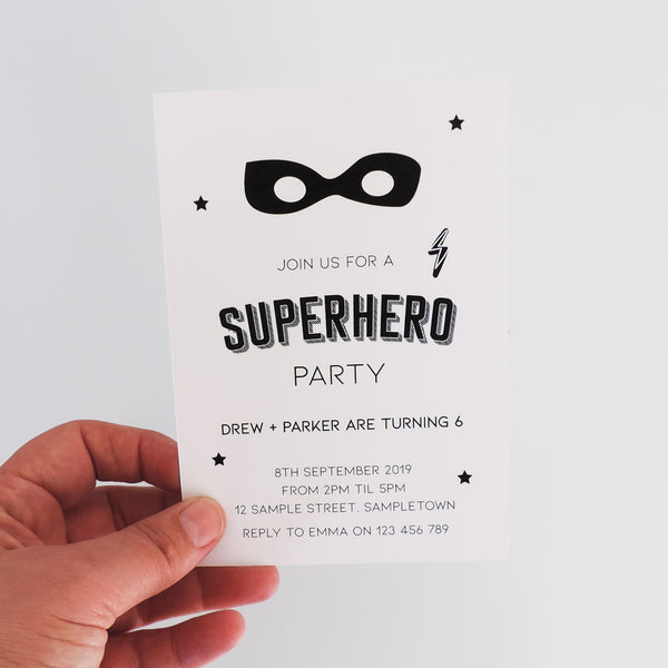 Customised black and white Superhero Birthday Party invitation. Affordable Printable. Emma Smith