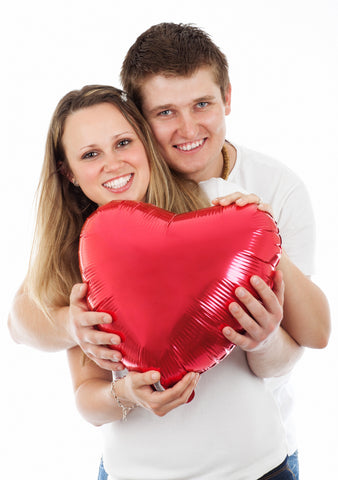 happy couple with heart balloon