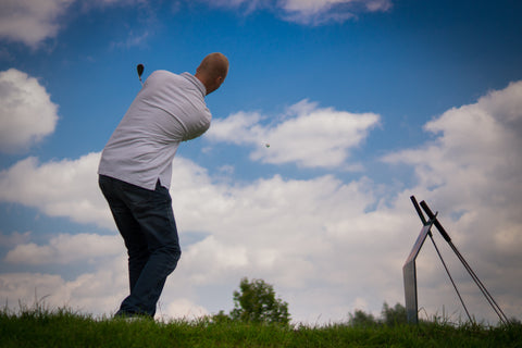 Golf player hitting ball