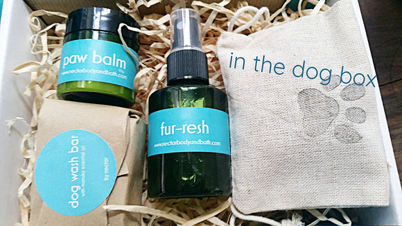 curated cardboard box filled with dog products, wash bar, fur-resh spray, paw balm and linen bag with poo bags