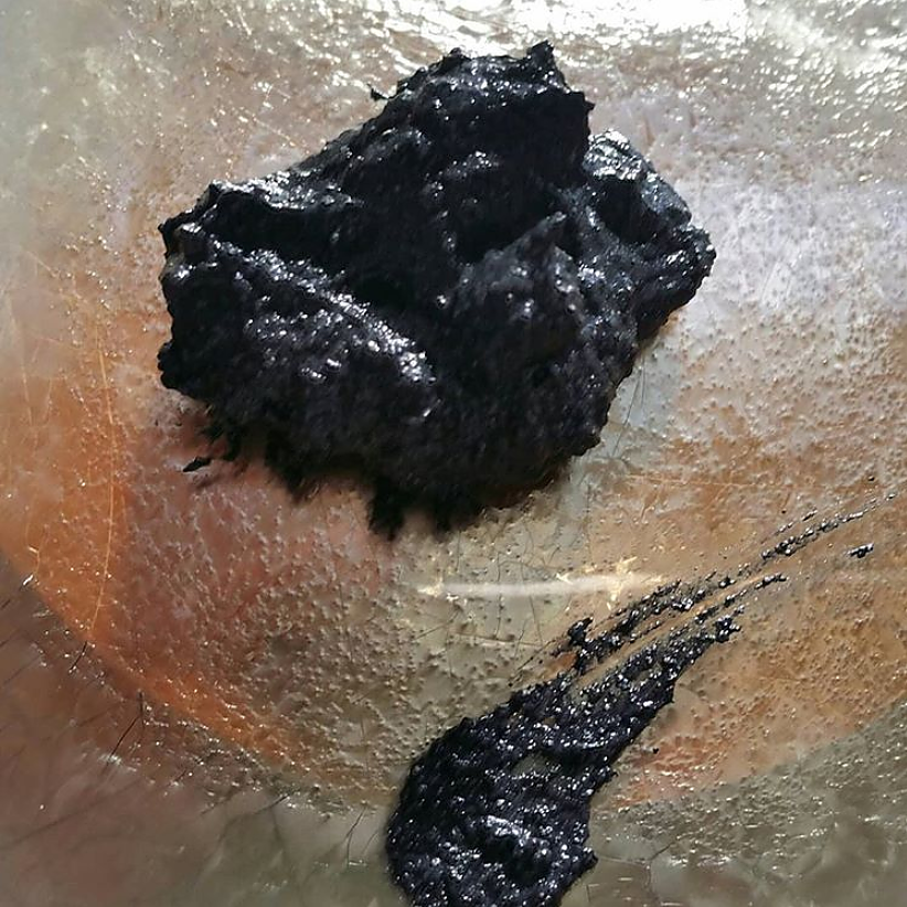 charcoal mask ready to use on a gold plate
