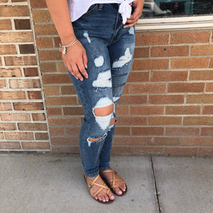 All Over Distressed Skinnies