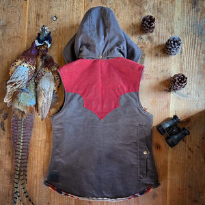 Custom waxed canvas vest with western style yoke and detachable hood.