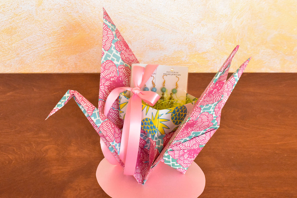 Sweet little gifts arrive on the wings of this elegant origami crane gift wrap designed by Shiho Masuda of Paper Guru.