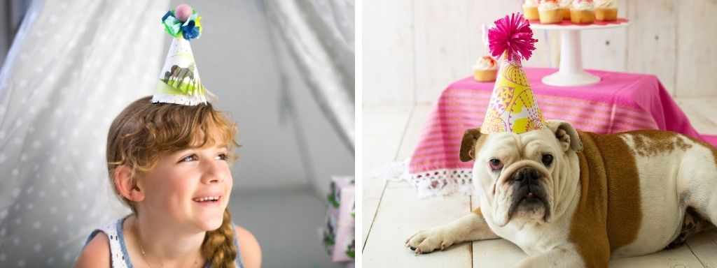 Girl with DIY Wrapping Paper Party Hat and Dog with Wrapping Paper Party Hat