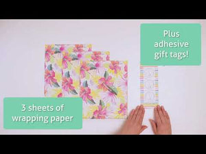 Opening a package of Wrappily Hibiscus Fan Palm Wrapping Paper.