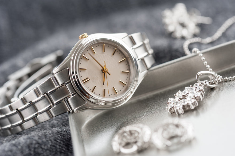 Upscale, luxury, Women's watch, silver and gold consignment boutique upscale designer resale
