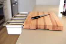 Wooden cutting board with attached food prep containers
