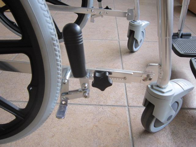"Portable GO-Anywhere Commode 'n Shower Chair – Self-Propel (SP) wheel locks on 20"" wheels – close-up"