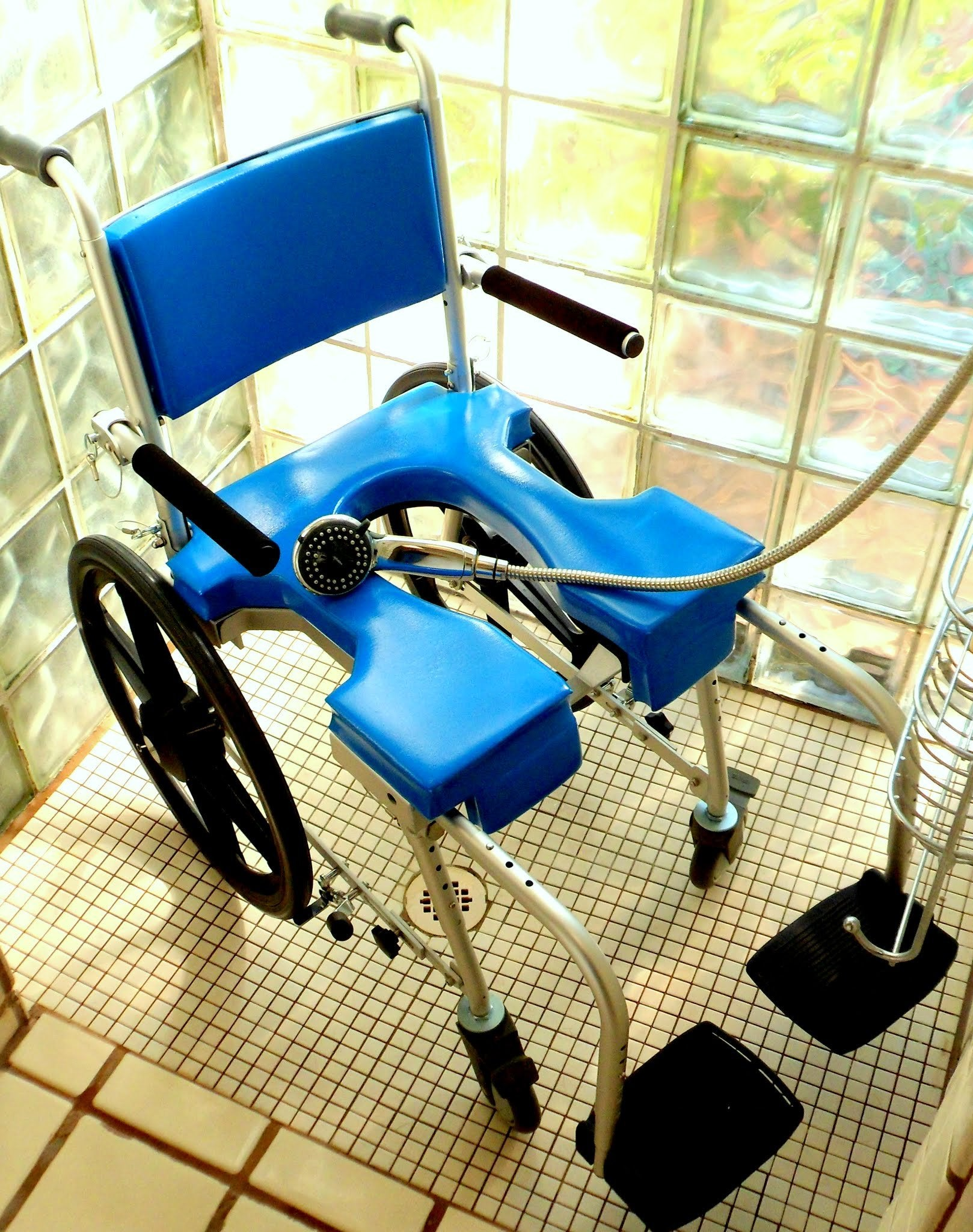 Portable GO-Anywhere Commode 'n Shower Chair – Self-Propel (SP) assembled and in roll-in shower – blue cushions