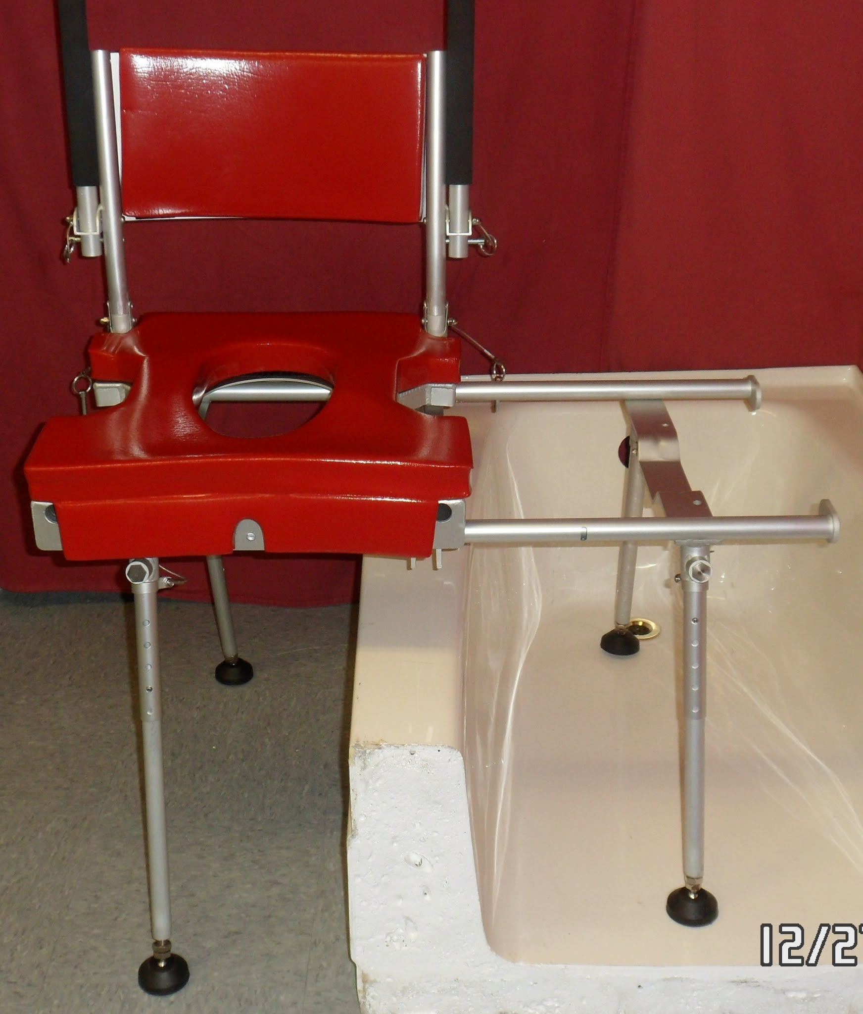 Portable GO-Anywhere Stationary Tub Slider (STS) over bathtub with seat assembly outside of tub – front view