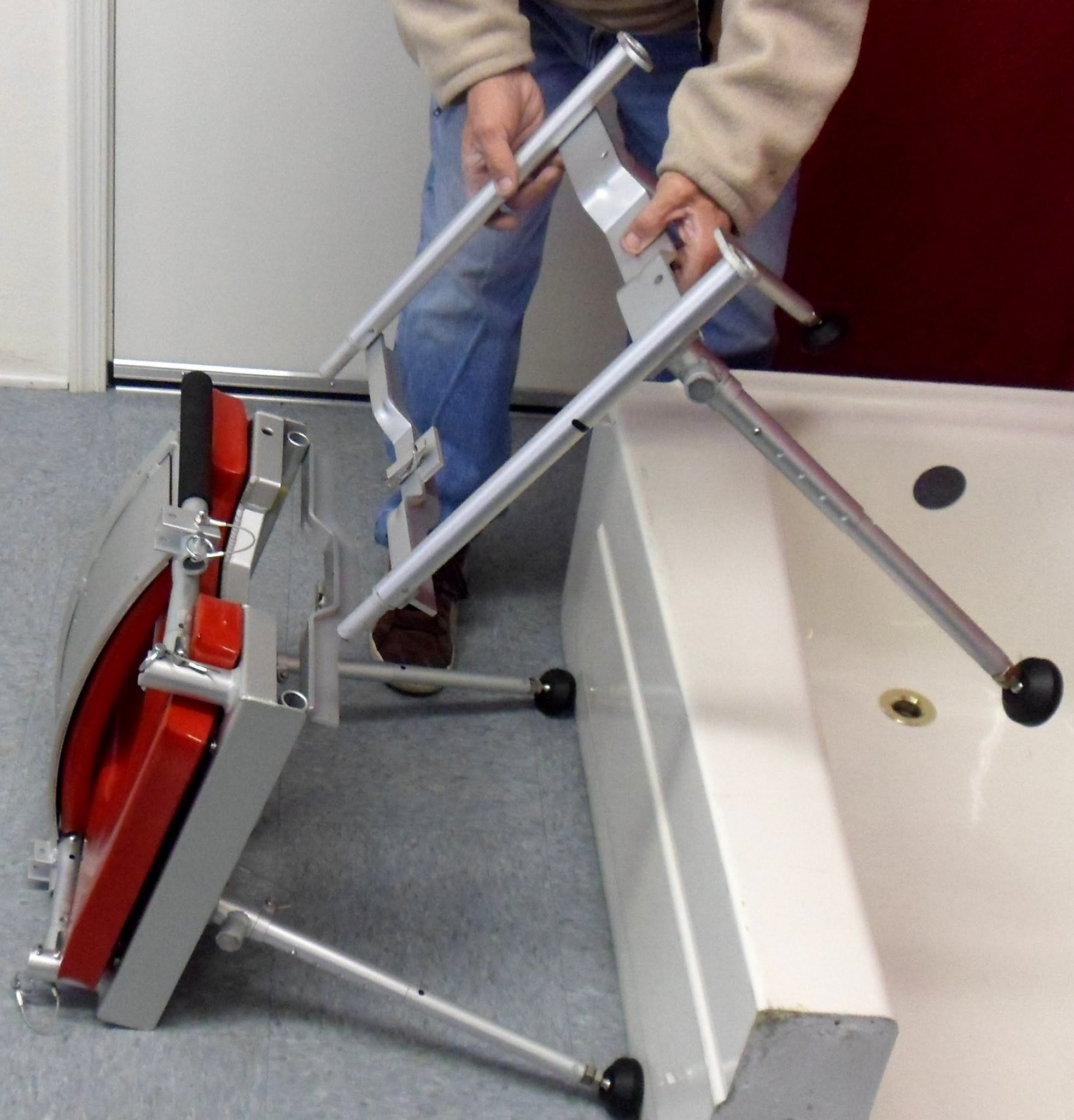 Portable GO-Anywhere Stationary Tub Slider (STS) being assembled and placed over bathtub