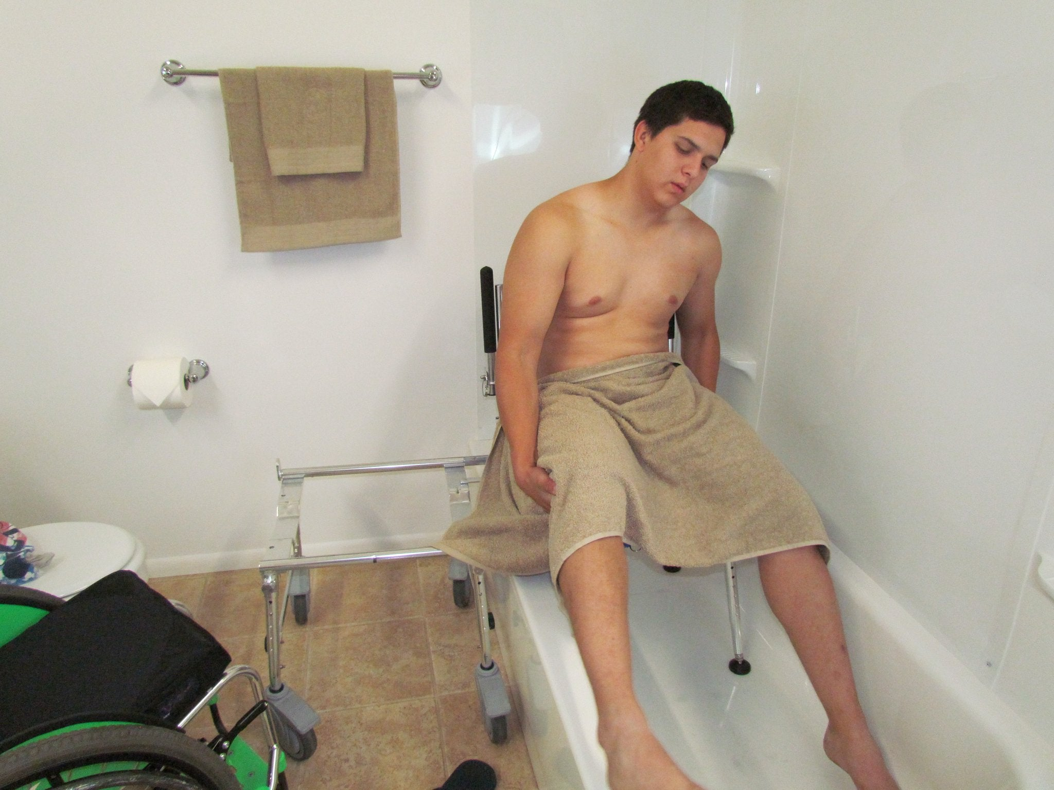 Portable GO-Anywhere Commode, Shower 'n Tub Chair (CST) user sliding into bathtub