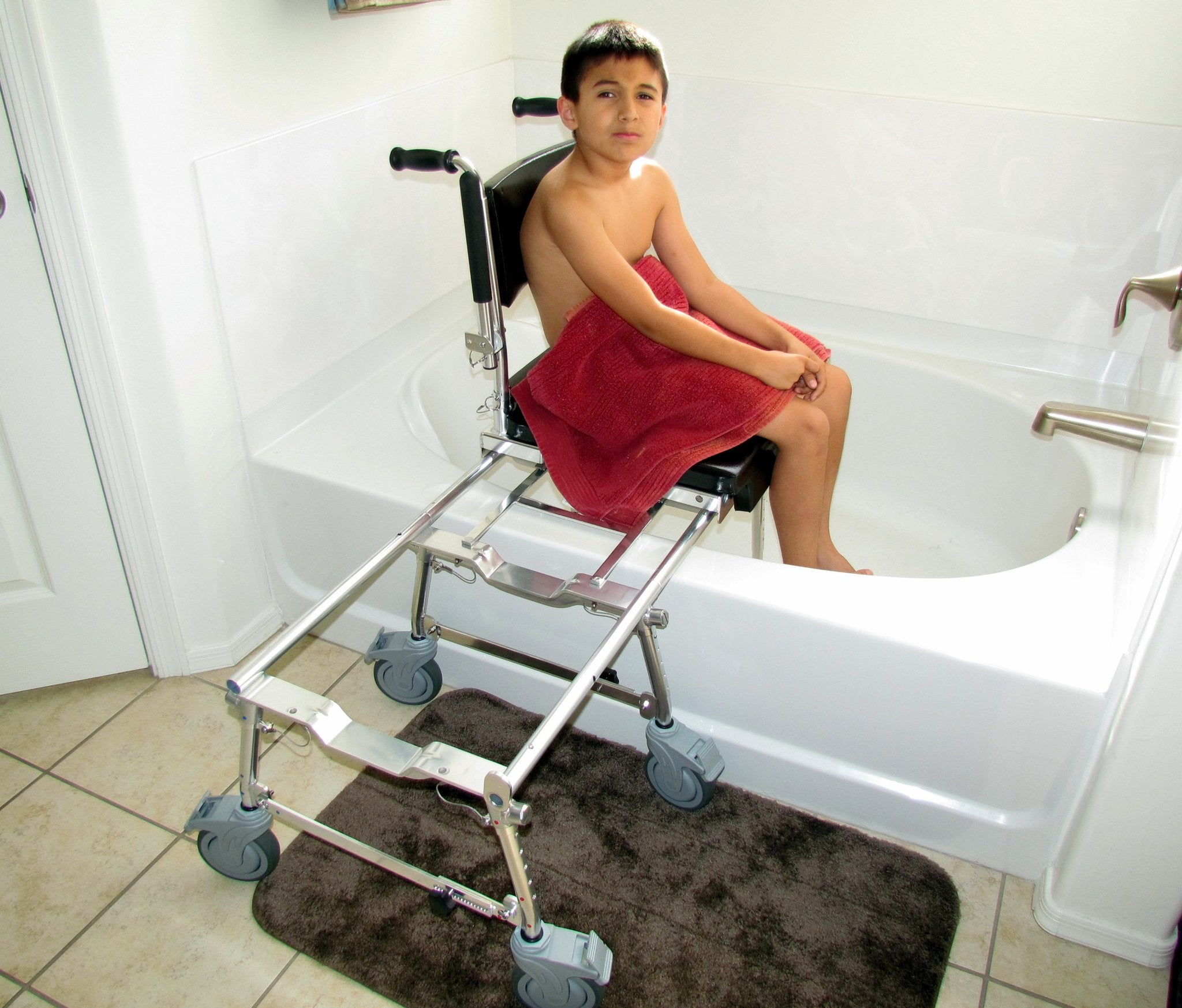 Portable GO-Anywhere Commode, Shower 'n Tub Chair (CST) pediatric user inside bathtub