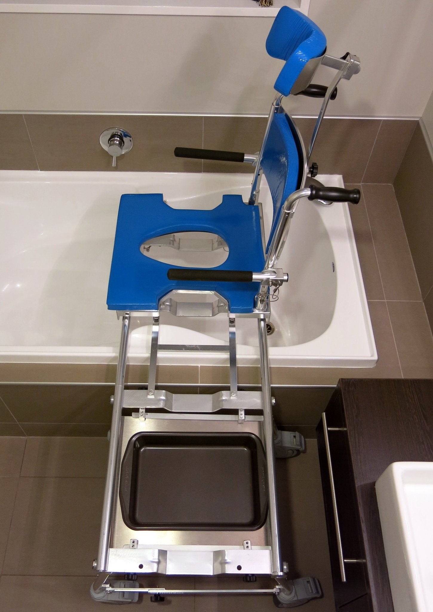 Portable GO-Anywhere Commode, Shower 'n Tub Chair (CST) slid to inside of tub