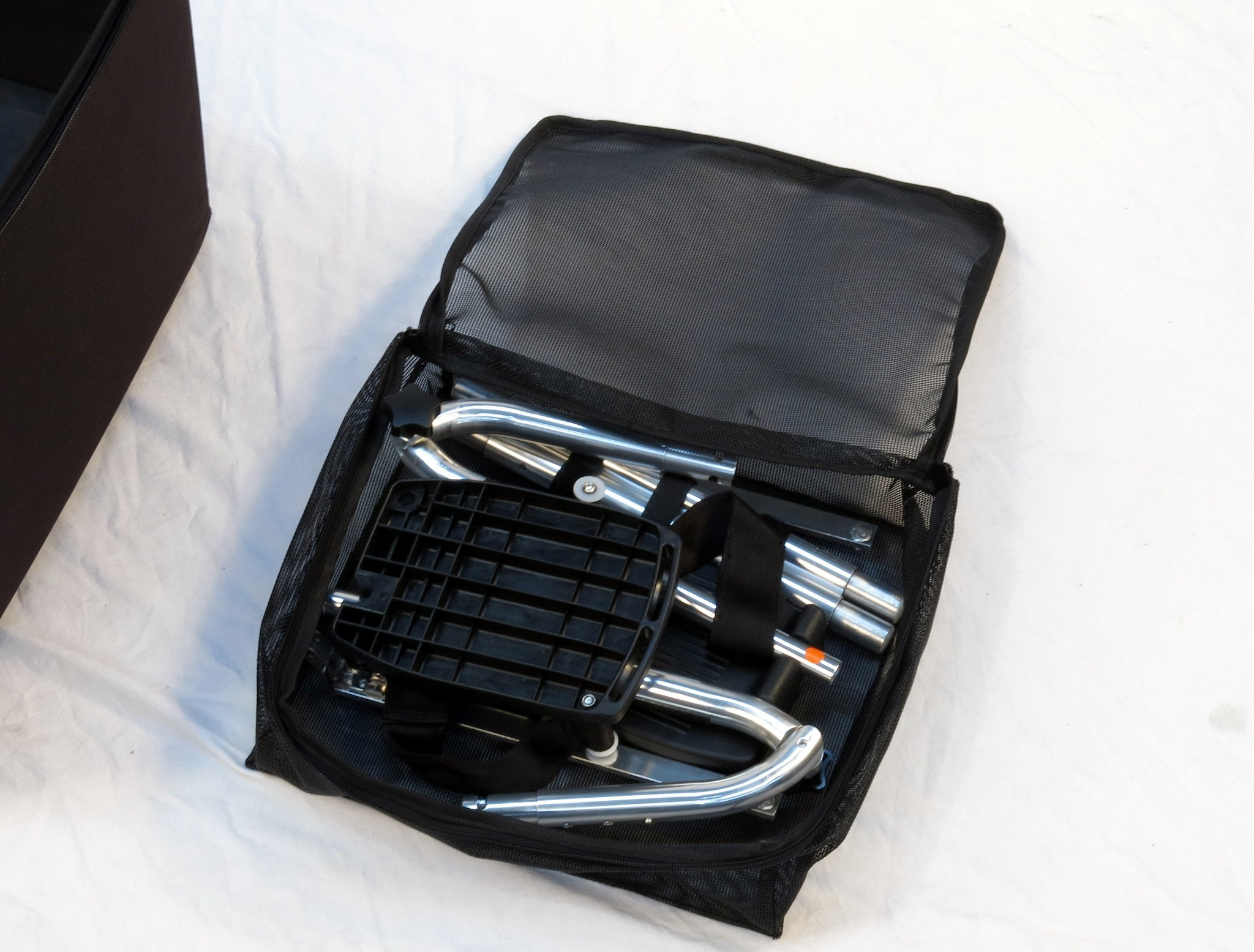 Portable GO-Anywhere Commode, Shower 'n Tub Chair (CST) accessories being packed into travel bag