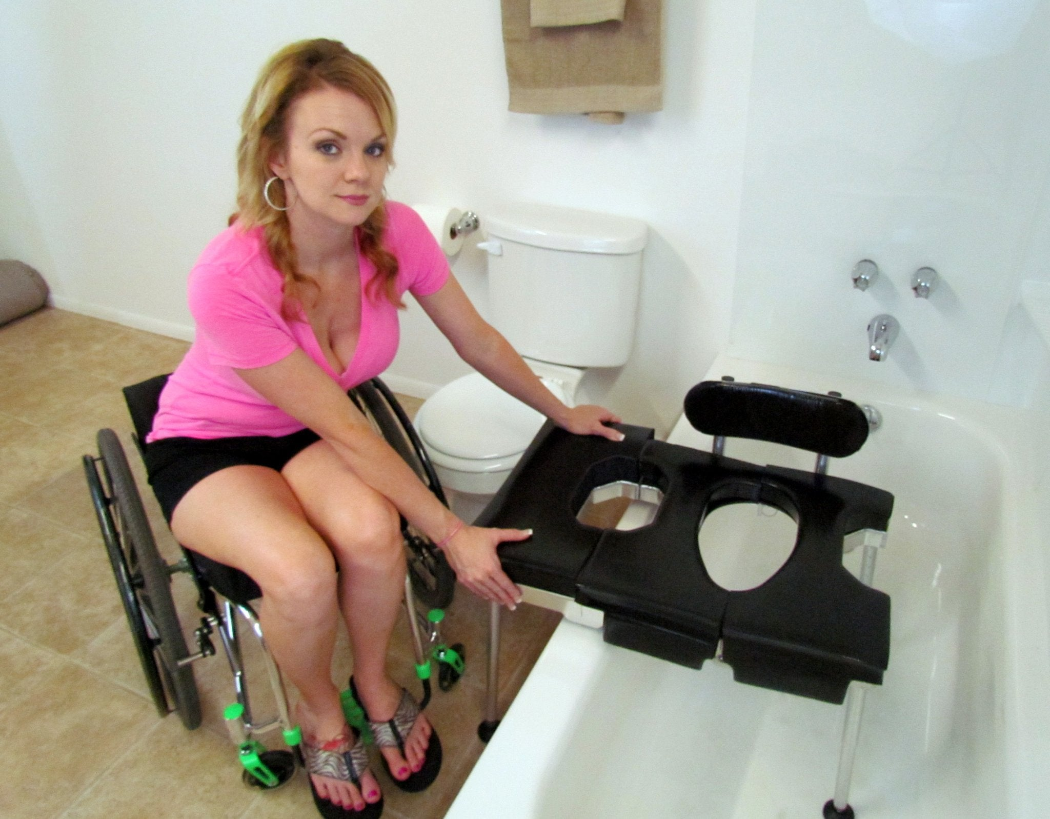 Portable GO-Anywhere Sport Tub Bench (SPT) being placed in bathtub with Transfer Section and backrest