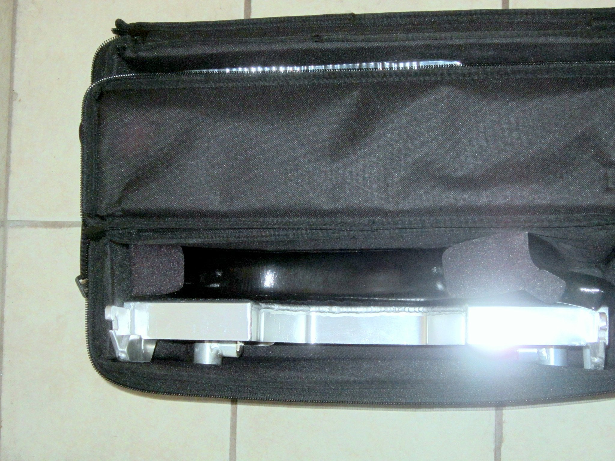 Portable GO-Anywhere Sport Tub Bench (SPT) Transfer Section visible packed inside travel bag