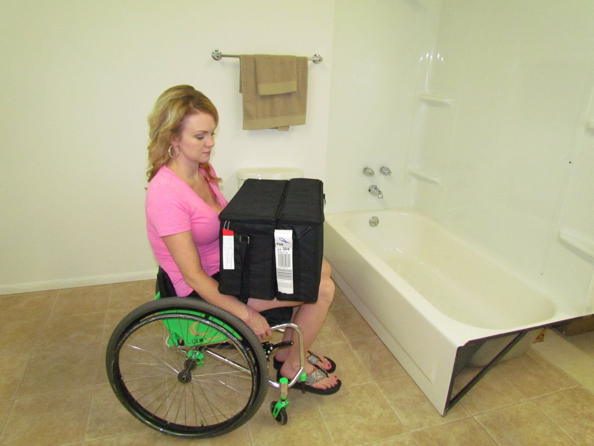 Portable GO-Anywhere Sport Tub Bench (SPT) and Transfer Section packed in travel bags shown on lap