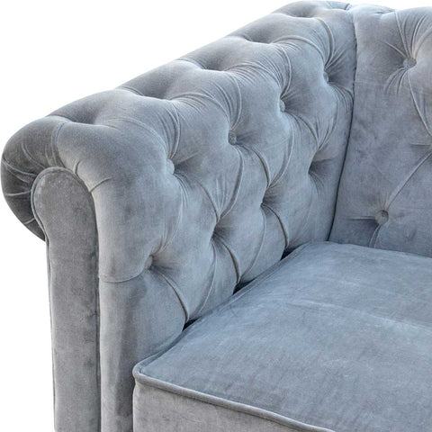 Artisan Grey Velvet Two Seater Chesterfield Sofa with Mango Wood Legs available at Unusual Designer Gifts front angle view