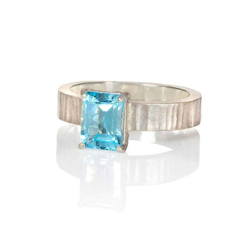 Camilla West handmade bespoke designer jewellery silver ring set with a rectangular 6x8mm blue topaz gemstone