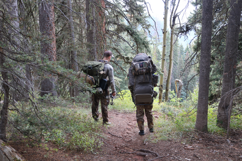 Cro-Mag Outdoors' Chris and Aidan walking with packs on at Colorado GMU 74