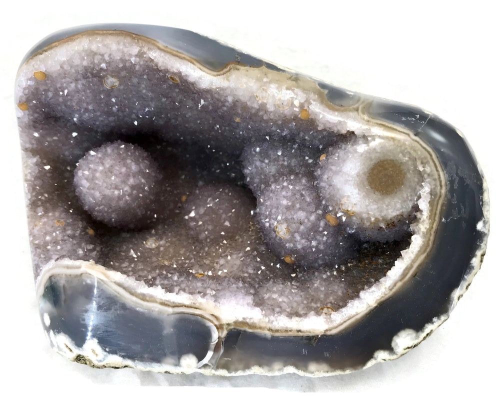 Nodules of Amethyst Filled Agate Geode