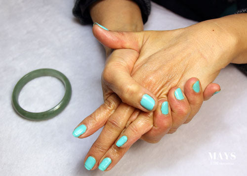 Massaging palm and knucles to fit a jade bangle