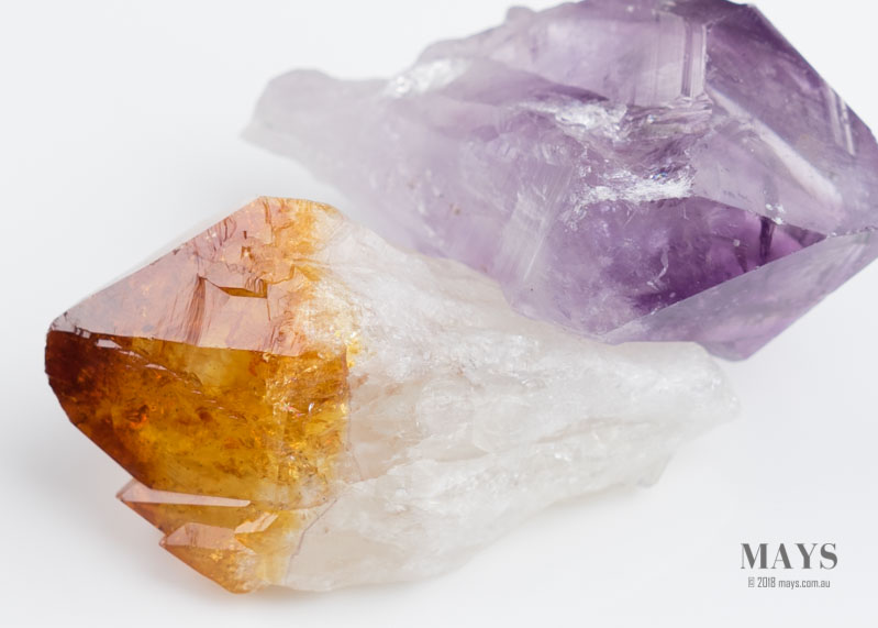 A pair of Quartz crystals: Amethyst and Citrine. Definite geometric faces seen in the form of a rhombohedral.
