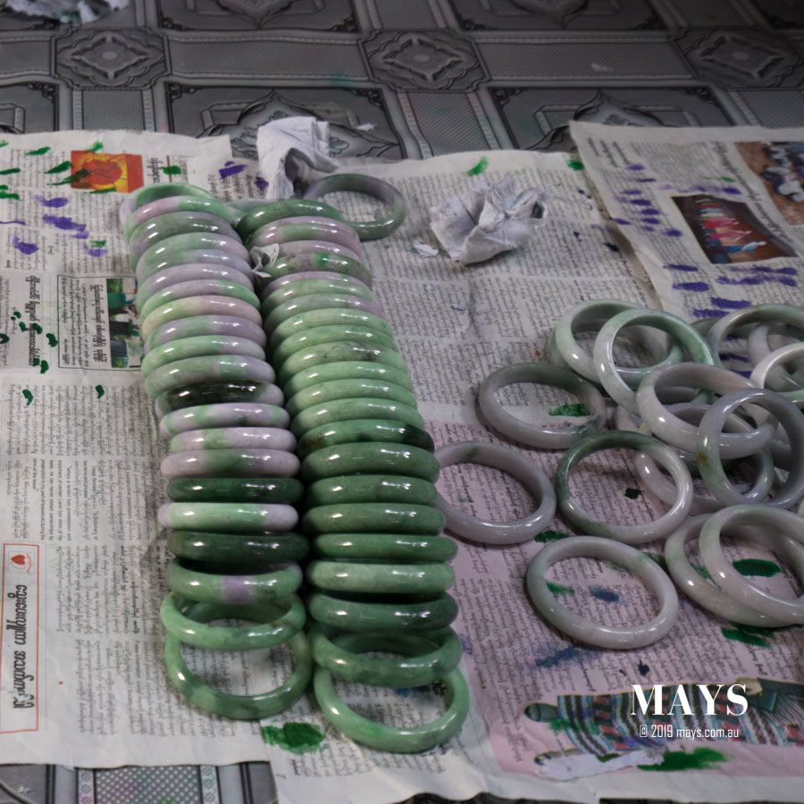 Comparison between treated and natural jade bangles.