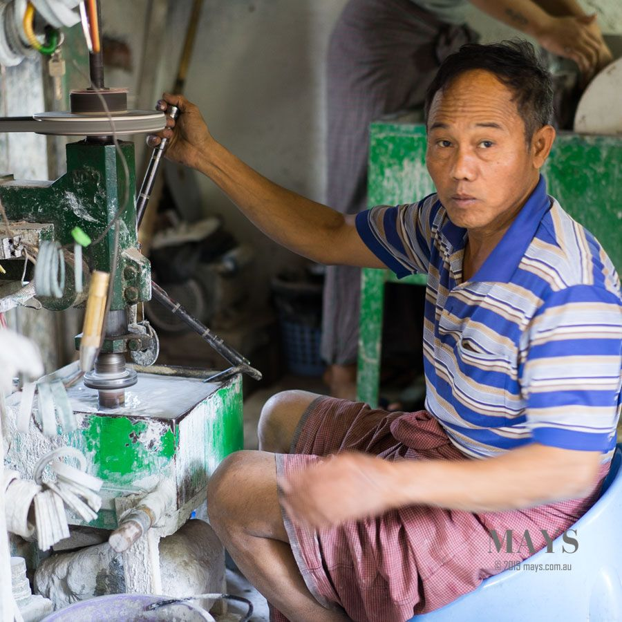 The driller uses a specialised drilling machine to form rough jadeite bangles.