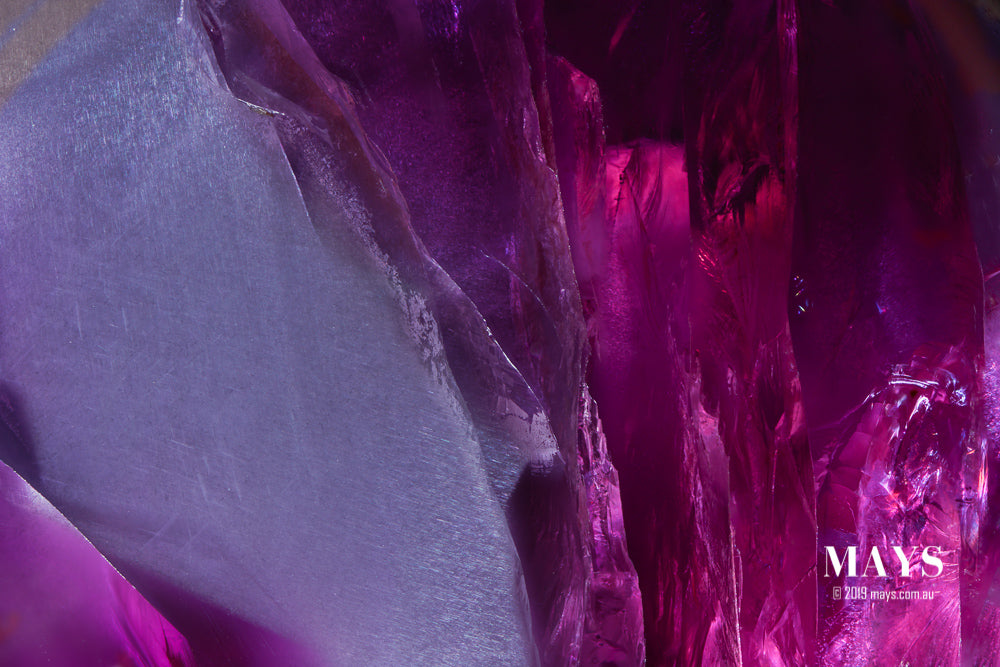 Welcome to the entrance of the Pleochroic Crystal Cave. A gap in the dense clouds of rutile needles on the surface of this star sapphire reveals a clear ice like crystal quality underneath.
