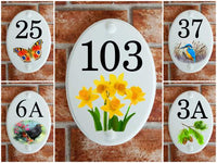 Ceramic style house number plaques with motifs