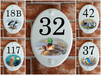 House number signs with animal picture motifs
