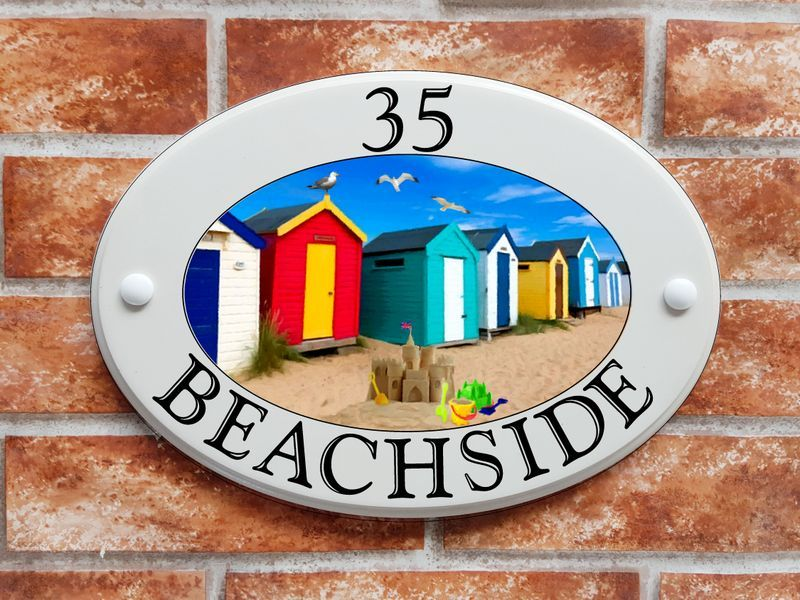 Beach huts by the sea - House Sign Shop