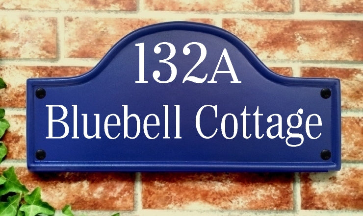 Blue bridge top sign displaying 132A Bluebell Cottage