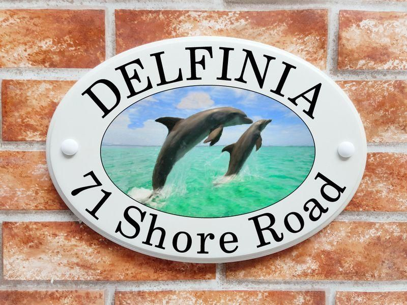 Dolphins leaping from the water - House Sign Shop