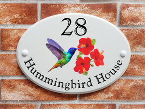 hummingbird feeding on hibiscus flowers pictorial on house plaque