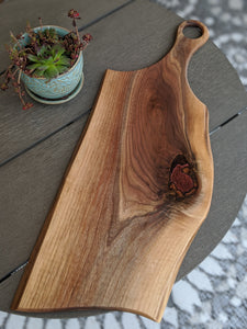 walnut charcuterie board with handle.