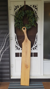 Ash Charcuterie Board standing against farm house door